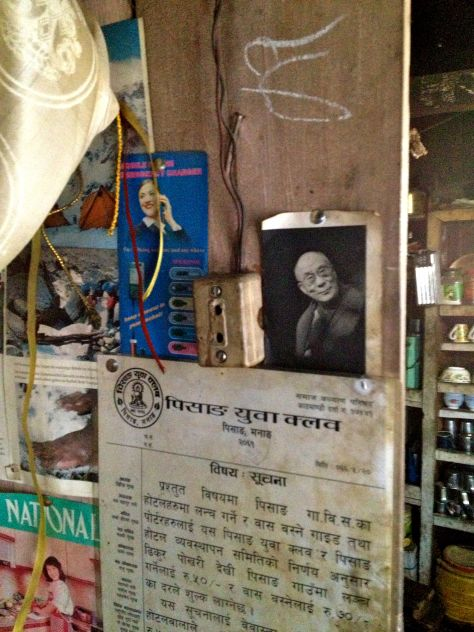 "Photo of the Dalai Lama hanging on the wall of the livingroom at the ""Himalayan Hotel"" lodge."