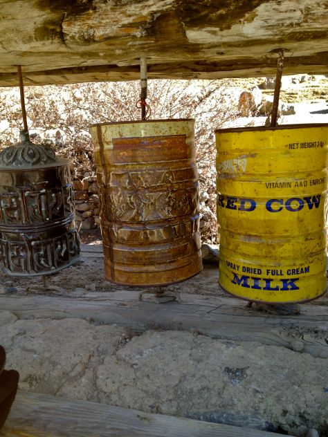 The cow beeing holy makes cow milk cans a good substitute for broken prayer wheels