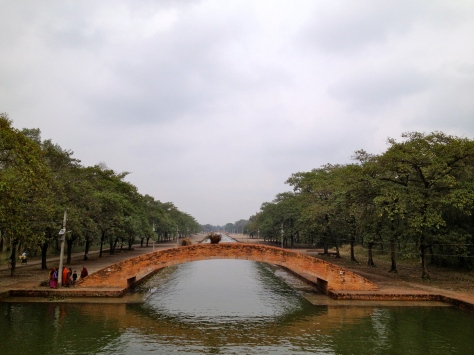 The canal with the eternal peace flame at one end and a holy pillar