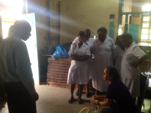 We were (here KJ) teaching one nurse from each department of Mawenzi how to use the manual suctionpumpt. The main points are to put water around the lid to close it tightly and fold the tube for vacuu
