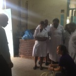 KJ is teaching how to use the manual suction pump at Mawenzi Hospital.