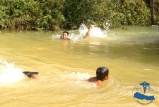 Kids were learning to swim using empty water bottles to keep them floating.