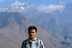 Dr Saujan Shrestha at the at the Rukum Mountain range (Dhaulagiri), Sisne peak in the background