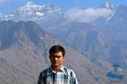 Dr Saujan Shrestha at the at the Rukum Mountain range (Dhaulagiri), Sisne peak in the background