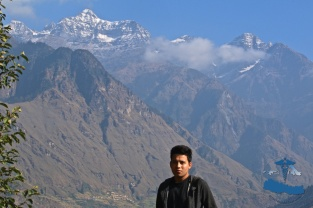 Mr Rajkumar Silwal at the at the Rukum Mountain range (Dhaulagiri), Sisne peak in the background