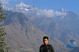 Mr Rajkumar Silwal at the at the Rukum Mountain range (Dhaulagiri), Sisne peak in the background